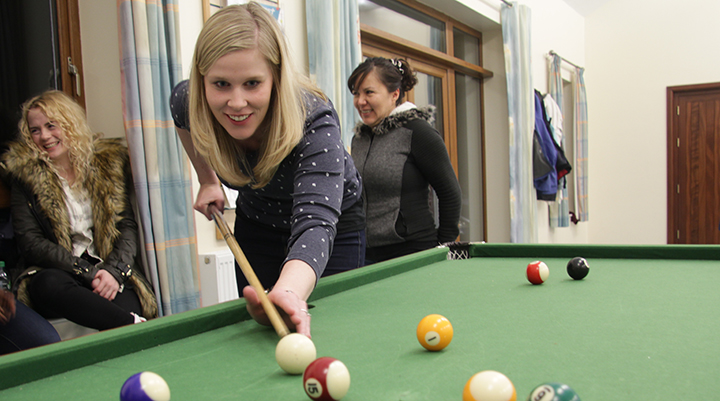 Yvonne playing pool at last year's weekend away